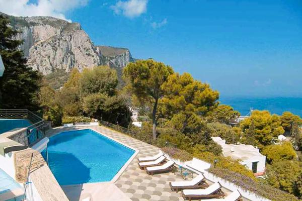 High on Castiglione hill, this villa offers breathtaking views of the Mediterranean, Mount Vesuvius and Capri. LDG GUI - Image 1 - Capri - rentals