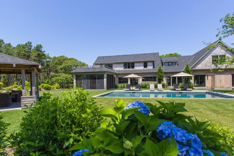 View of yard, pool, pool cabana with fireplace and house - DICKT - Luxurious Katama Retreat, Ferry Tickets, Heated Pool, Cabana with Fireplace,  Expansive Deck and Patio, Screened Porch - Edgartown - rentals