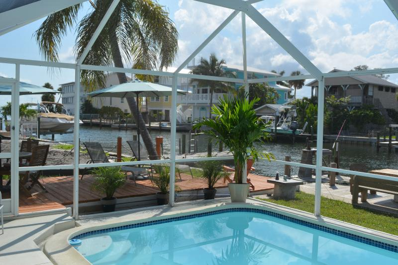 Relax in or by the heated pool on the water - Blue Heron Waterfront House Anna Maria island - Anna Maria - rentals