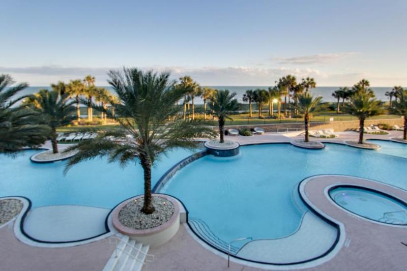Spectacular beachfront condo w/ flatscreen Apple TV + shared pool & hot tub! - Image 1 - World - rentals