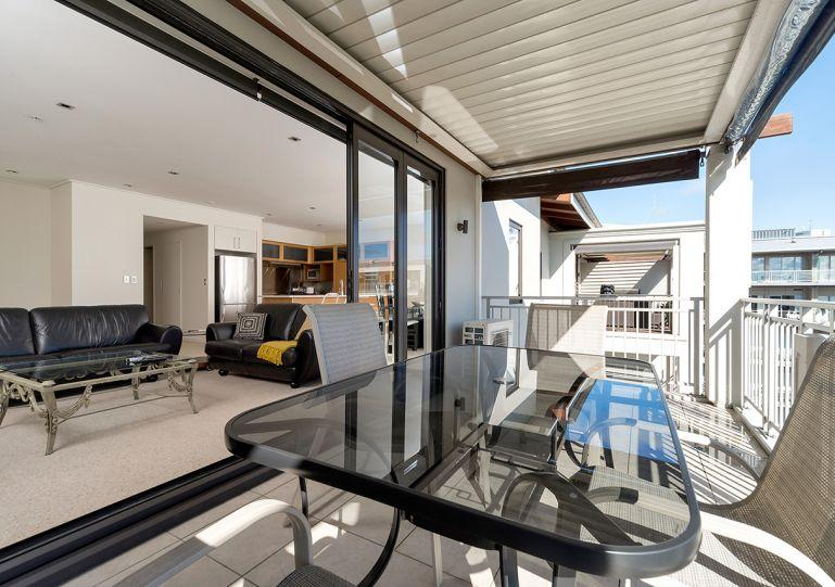 Living area opens onto the balcony - Auckland Viaduct Airconditioned Apartment 2 Bedrooms, 2 Bathrooms,  Carpark - Auckland - rentals