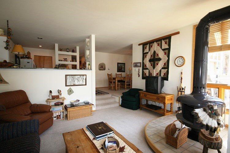 Living room with a queen sleeper sofa. - River Glen 102C Vacation Condo - Frisco - rentals