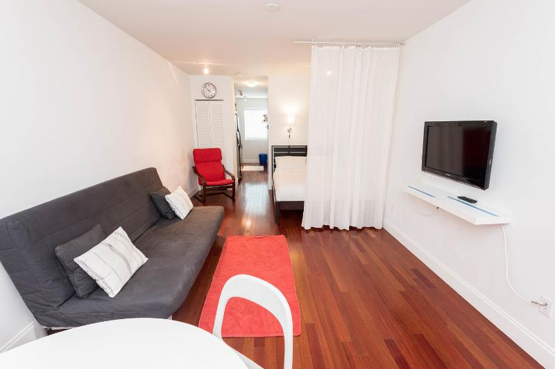 Living Room - Cozy, Large Studio Best location in SoBe . WIFI, central AC, full kitchen. - Miami Beach - rentals