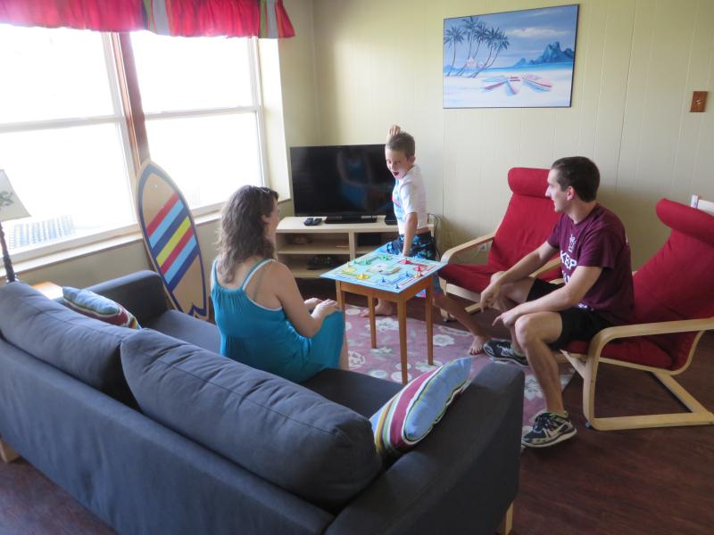 Main room game time - Families & kids love to stay at the Sandy Turtle - Port Aransas - rentals
