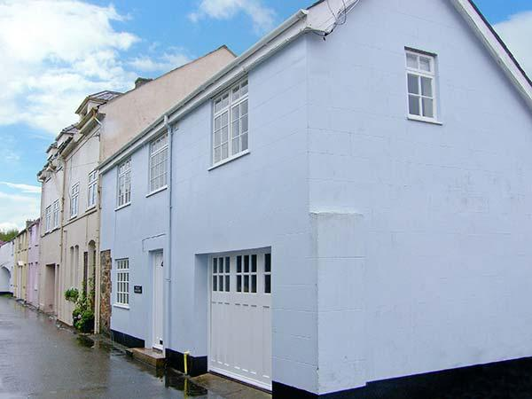 THE OLD COACH HOUSE, three bedrooms, summer room, enclosed patio, walking - Image 1 - Beaumaris - rentals