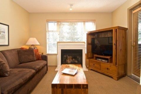 Beautiful Bright Living room vaulted ceiling and access to deck - Glacier Lodge Executive Condo with Loft sleeps 6 Unit # 342 - Whistler - rentals
