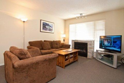 Spacious Living room with big screen TV, Sofa bed and fireplace - Glacier Lodge remodeled 2 bed condo facing interior courtyard and pool. Sleeps 7 Unit # 254 - Whistler - rentals