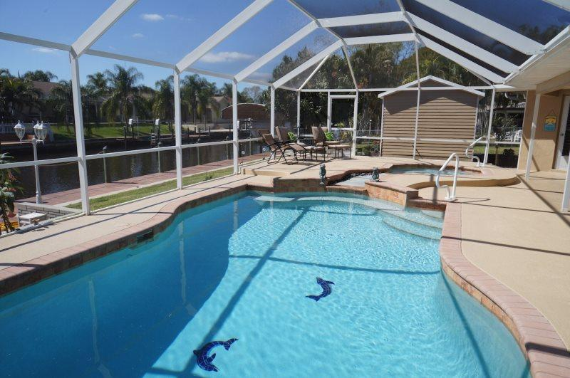 Serenity - Cape Coral 3b/2ba home w/electric heated pool/spa, gulf access canal, HSW Internet, Boat Dock - Image 1 - Cape Coral - rentals