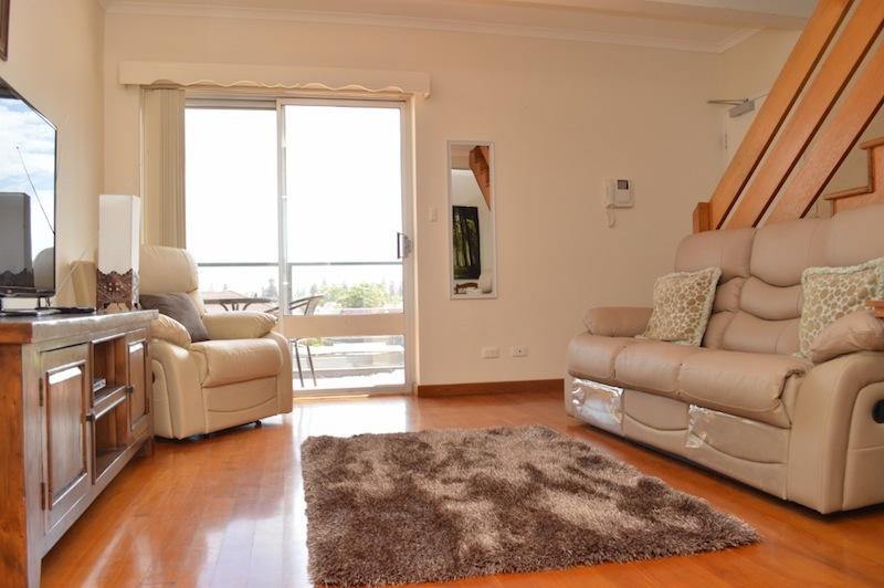 Lounge room with balcony and ceiling fan - Sea Breezes at Henley Beach - South Australia - rentals