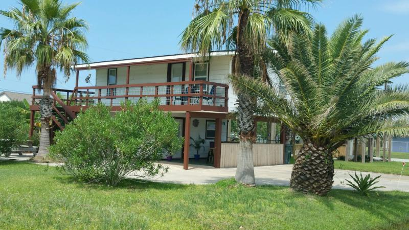 Side view with lot's of palm trees surrounding house. - West End Sea Isle House - Galveston - rentals