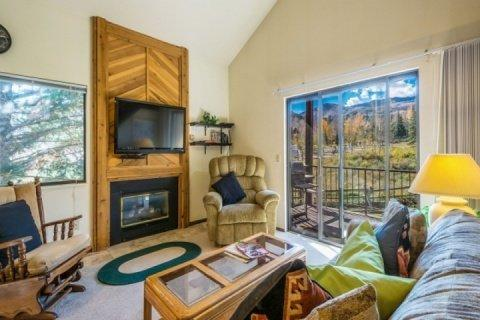The main floor living room features plush furnishings, fireplace, 50