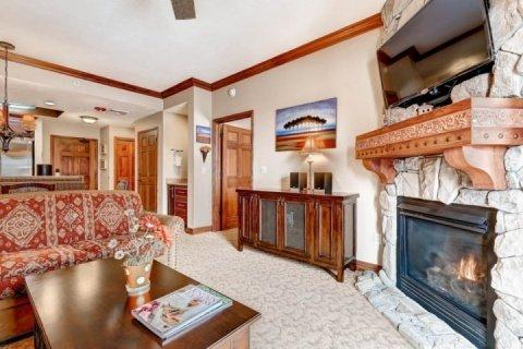Elegant 1 Bedroom, 1 Bathroom Condo at Westgate; large living room with stone fireplace, 42