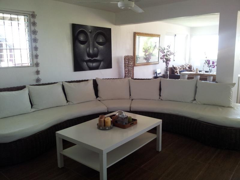 this amazing couch fits 8 people - Design Penthouse with roof top terrace  sleeps 6, - Puerto Plata - rentals