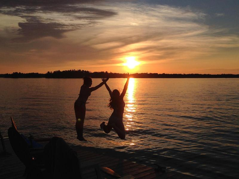 Swimming in the sunset right from our dock! - Cottage & Shoreside Games Cabin, Six Mile Lake, Muskoka ON - Muskoka Lakes - rentals