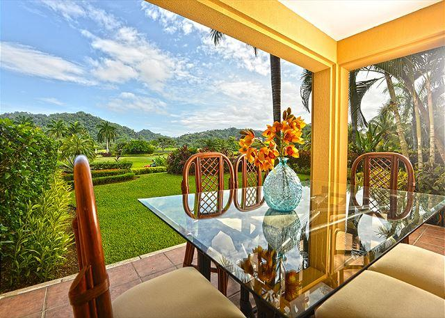 Patio outside with view of the golf course. - Your Dream Vacation Luxury Condo Awaits! Overlooking Greens at Los Sueños! - Herradura - rentals