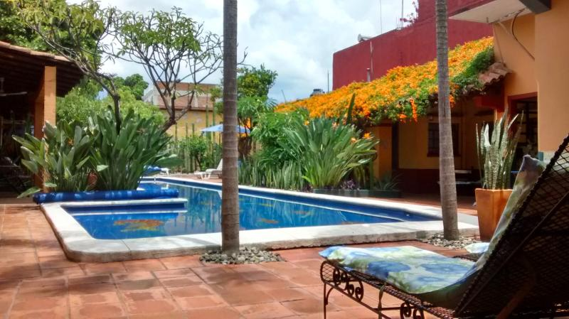 View from the Villa del Sol of the pool and the patio of the Bird of Pardise. - Villa with Pool & Gardens in Historic Center - Oaxaca - rentals
