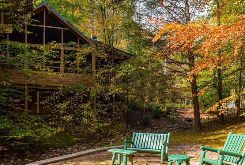 Brilliantly colored leaves grace the cabin in autumn. - WOODLAND OASIS--The Name Says it All! - Pigeon Forge - rentals