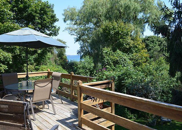 The deck has a peek-a-boo view of the sea. - Garden by the Sea: Relax & enjoy wonderful coastal views. Walk to the beach! - Gloucester - rentals
