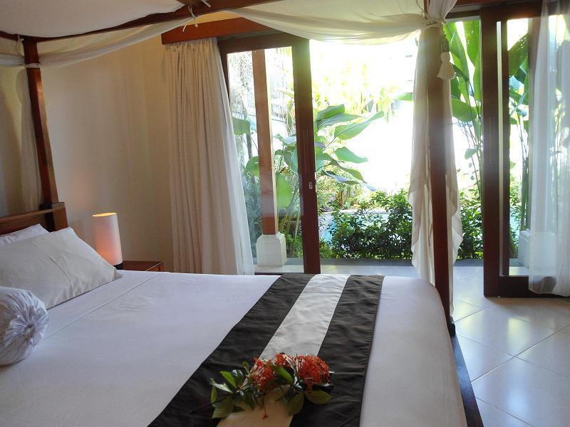 Main bedroom opens onto the verandah and beyond to the natural stone pool. - 2 bed /pvt pool easy walk to beach & restaurants - Sanur - rentals