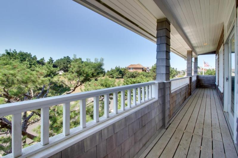 Peek-a-boo ocean view with a hot tub and room for 8 await! - Image 1 - Gearhart - rentals