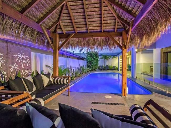 Enjoy sitting under the cabana overlooking the pool. - AQUA PALMS   ** PAY 5 STAY FOR 7 IN JULY ** - Broadbeach - rentals