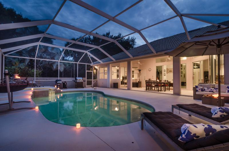 Immaculate 4 Bed/3 Bath Home with Pool & Spa, surrounded by tropical gardens just minutes to Downtown Naples & Gulf Beaches! - Image 1 - Naples - rentals