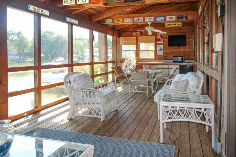 Colorful waterfront home on canal w/ private hot tub, dock & entertainment! - Image 1 - Ocean City - rentals