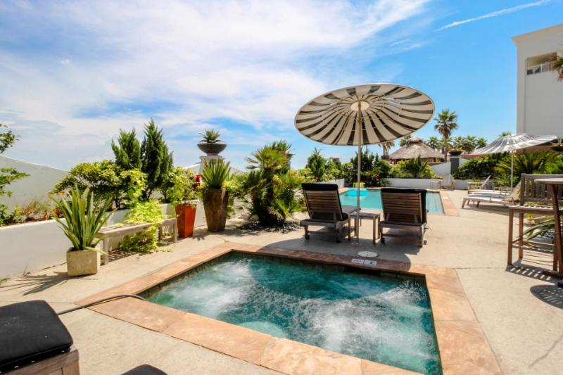 Colorful, oceanfront condo w/ shared pool & hot tub - Dogs OK! - Image 1 - Galveston Island - rentals