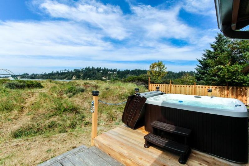 On Alsea Bay with bridge views, hot tub, dog friendly. - Image 1 - Waldport - rentals