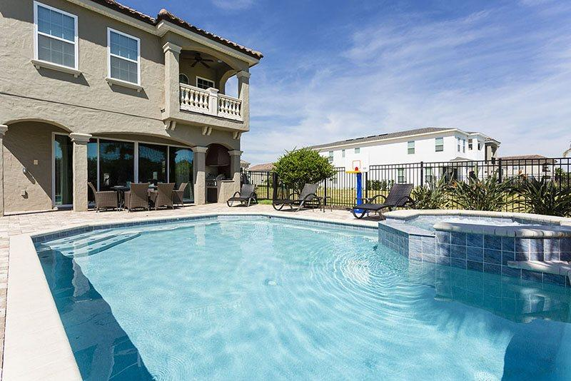 Large 30 x 25 ft pool with spill over spa - Showcase Villa | Luxury Pool Villa Featuring Two Disney Themed Bedrooms, Summer Kitchen, Pool Table, Air Hockey & Foosball - Kissimmee - rentals
