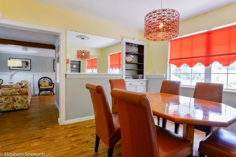 Separate dining room with table seats 6-8 - Charming Harbor Mist - 2 bedroom Marina home - Gulfport - rentals