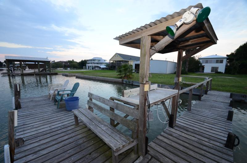 Enjoy fishing/boat dock with bench and chair setting.Clean your catch at the lit fish cleaning table - Sunset Ridge: 3/1 Waterfront  w/dock & boat ramp! - Rockport - rentals