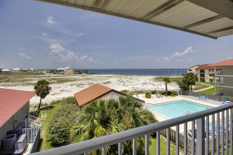 Watch incredible sunsets from this lovely condo. Shared pool access! - Image 1 - Navarre - rentals
