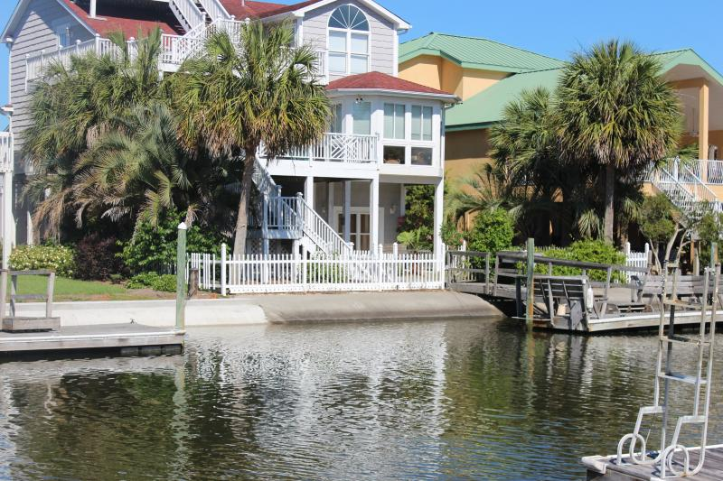 Canal Waterfront, private dock lower right of photo, fenced back yard, Widow's watch on top level. - Canal Waterfront-6BR-Golf Cart,Kayak,Pool-37Moore - Ocean Isle Beach - rentals
