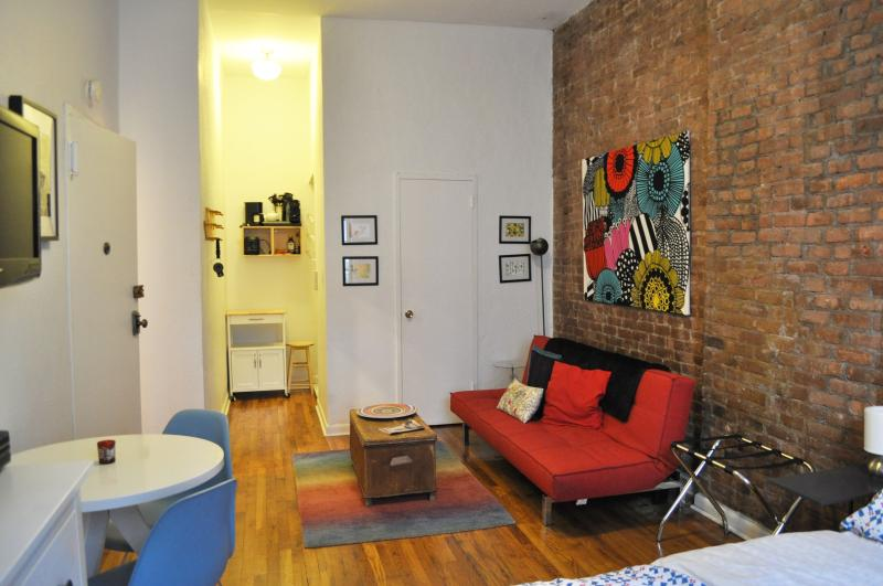 A large, open studio with a queen bed plus sleep sofa, and dining table for up to three. - Large Studio in Pre-War East Village Townhouse - New York City - rentals