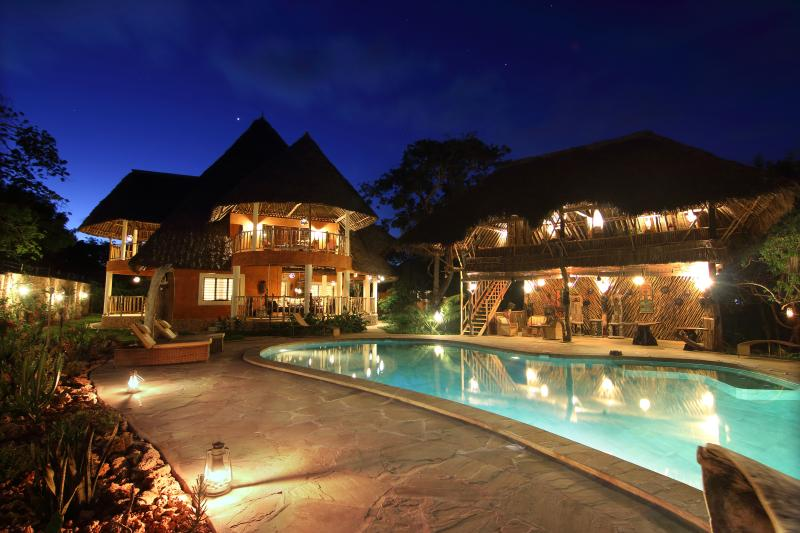 View to Villa at night from Waterfalls - Luxury Villa Ndoto - Cook,Pool,Cave & Waterfalls - Diani - rentals