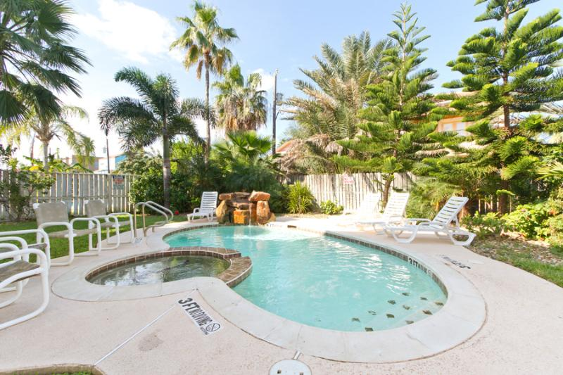 A sparkling  pool is heated for winter vacations and a hot tub is the perfect spot for relaxing year round.  A built-in BBQ pit is perfect for cooking your catch. - 118 E. Hibiscus - South Padre Island - rentals
