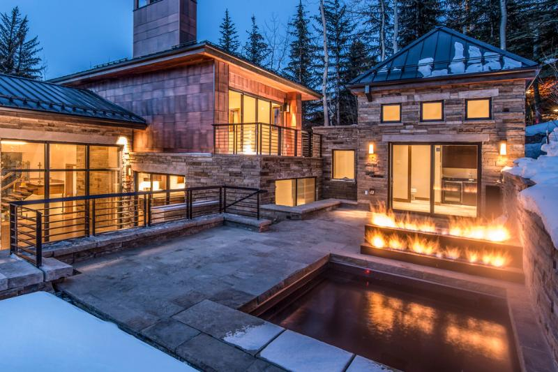 Enjoy a night out on your heated patio by the firepit, or in the in-ground hot tub. - Top of the Line 6 Bedroom Home on Forest Road! - Quantum - Vail - rentals