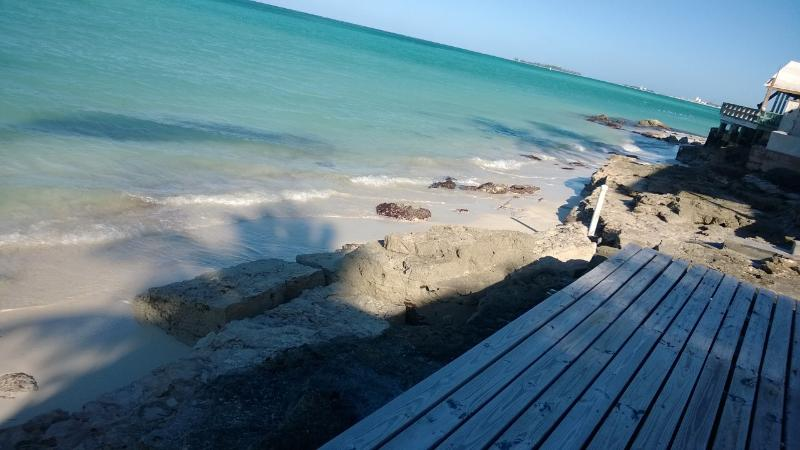 Standing on the deck at low tide. - Tangerine Sunsets North Coral - Nassau - rentals
