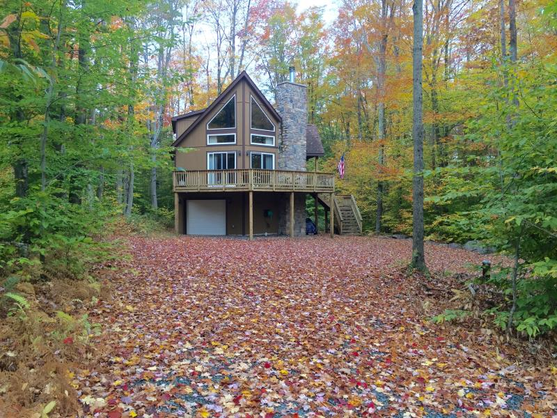 Fall foliage carpets the property - Upscale Poconos Lake Chalet w/Fplc, Fpit, WiFi - Pocono Lake - rentals