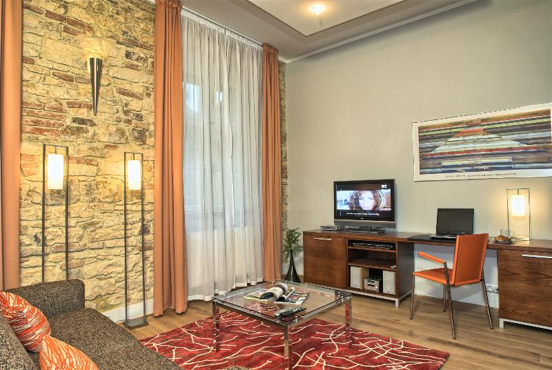 Living area with comfortable seating and working desk - Historical Center - Modern 1bdr | Rybna Residence - Prague - rentals