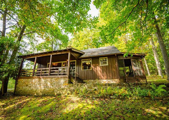 Exterior view with beautiful lush foliage and porch - OVR's Coldren Cottage! Secluded, cozy and warm in the lush mountains of PA! - Farmington - rentals