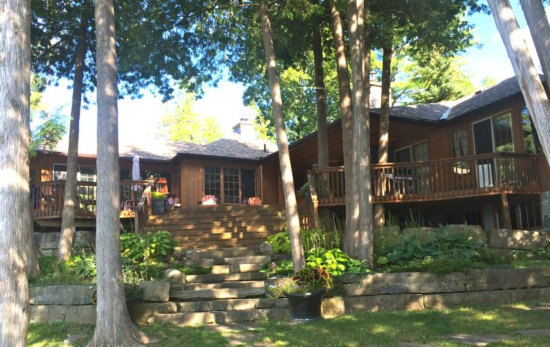 View of cottage from lake, amazing views from all rooms & large deck for relaxing & eating outside - Spacious, Modern & Private Lakefront Cottage - Kawartha Lakes - rentals