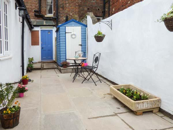 LITTLE TREASURE, ground floor coastal apartment, en-suite, dog welcome, in - Image 1 - Whitby - rentals