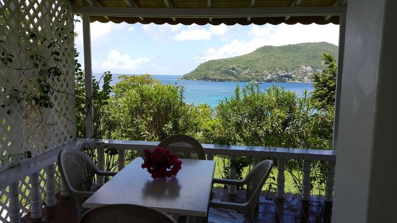 Alfresco Dinning with view of Admiralty bay - Sunset Cottage Apt. - Lower Bay - rentals