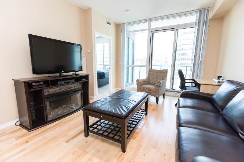 Living Room - Luxurious/Corporate One Bedroom + Den Condo  ~ Map - Toronto - rentals