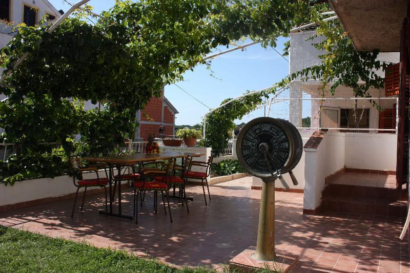 A1(2+2): garden terrace - 00610TISN  A1(2+2) - Tisno - Tisno - rentals