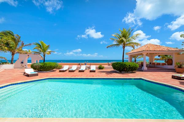 Directly on Baie rouge Beach, surrounded by tropical gardens. All rooms open to tiled terrace and pool. C ROD - Image 1 - Saint Martin-Sint Maarten - rentals