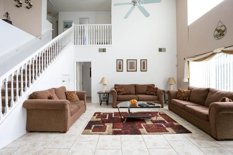 Living Room - Luxury Lakeside Villa with south facing pool & spa - Kissimmee - rentals