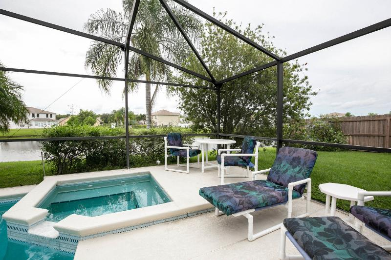 Spa overlooking large pool, lake and private gardens - Luxury Lakeside Villa with south facing pool & spa - Kissimmee - rentals